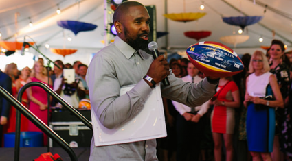 Charles Woodson at Event on Main