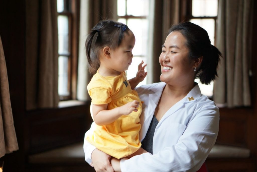 Grace Han and her daughter. Read Grace's U-M blog reflecting on the art of balancing life as a mother and a Med student.