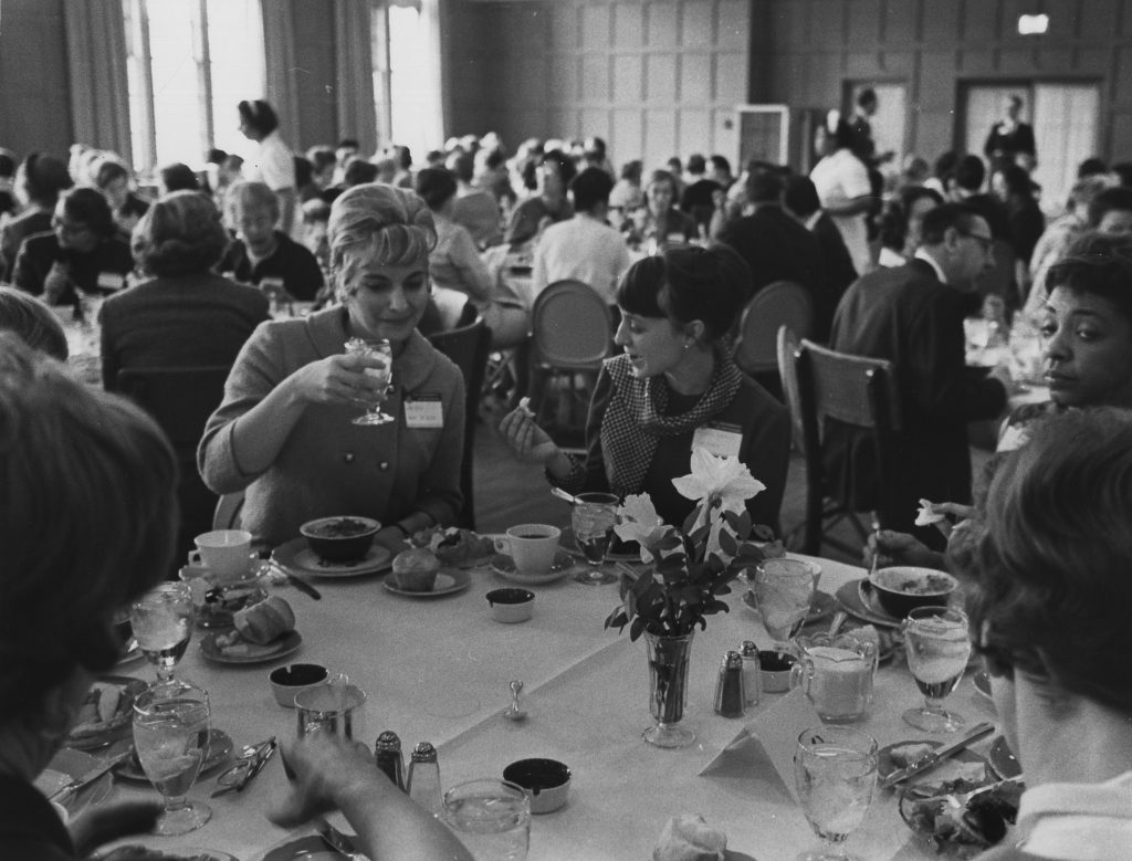 """A luncheon at CEW+'s first conference in 1965. """"Opportunities for Women through Education'' offered sessions on the career paths and required education for a range of fields."""