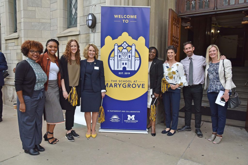 Marygrove students and staff members standing in front of the school's entrance.