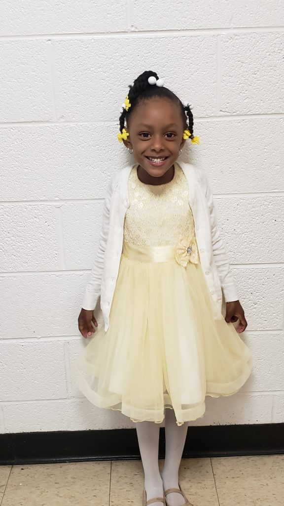 Photo of Skylar smiling and dressed up.
