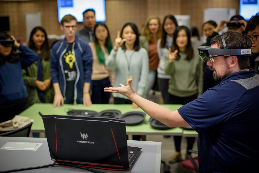 A group of U-M students trying out VR headset during class.