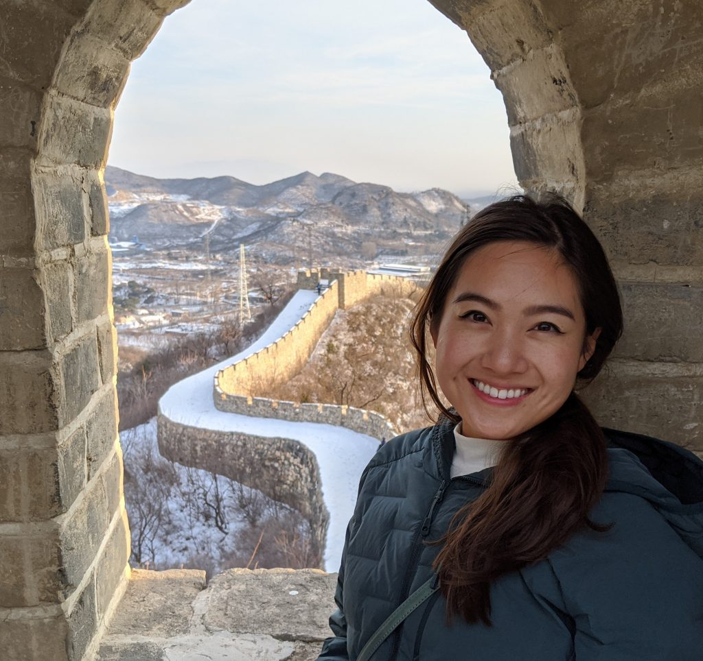 Zhao posing by the Great Wall of China